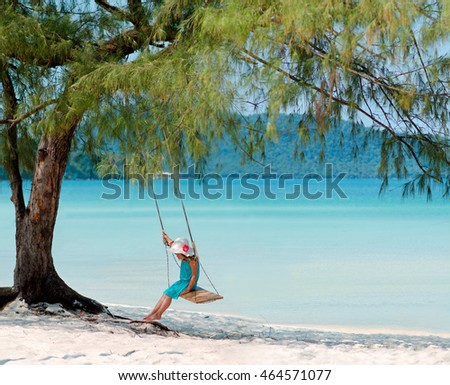 Girl on a swing at the beach