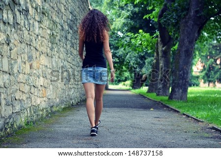 Girl on a walk - stock photo