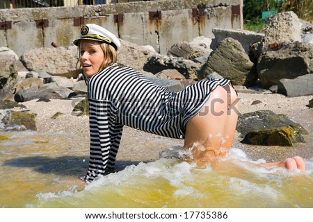 girl on all fours in beach