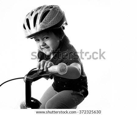 Girl on bicycle isolated on white
