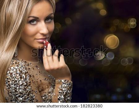 girl on boleh background with casino chips - stock photo
