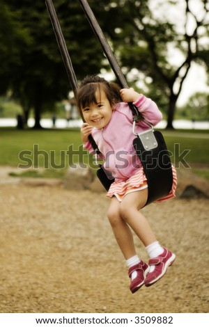 Girl on Cable Swing at a Park