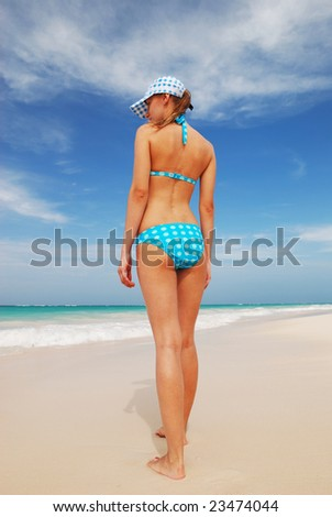 Girl on caribbean beach in Dominican Republic