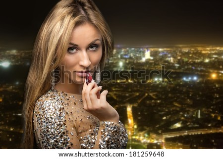 girl on city background with casino chips - stock photo