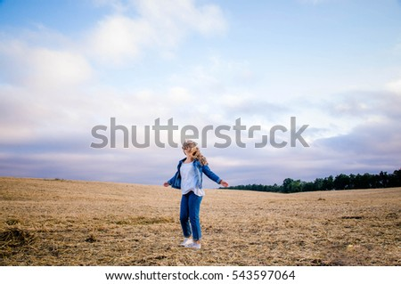 Girl on field with beveled wheat