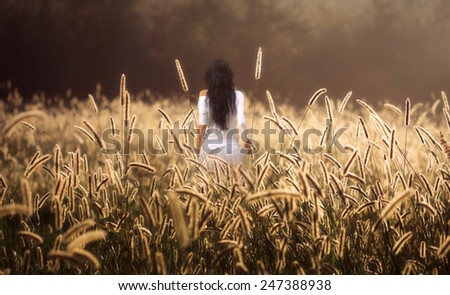 girl on golden background sunrise - stock photo