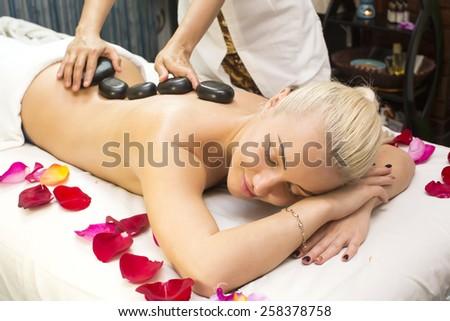 girl on procedure Balinese massage in the beauty salon - stock photo