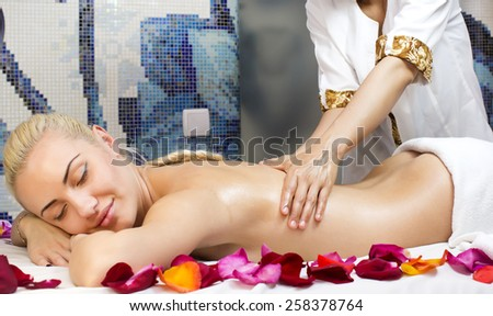 girl on procedure Balinese massage in the beauty salon - stock photo