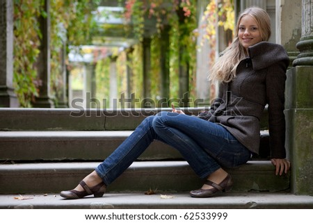 Girl on stairs - stock photo