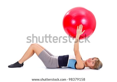 Girl on th floor with pilates ball doing exercises