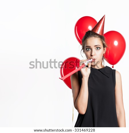 Girl on the background of balloons in festive costume celebrates birthday - stock photo