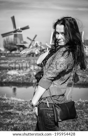 girl on the background of the mill