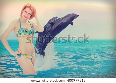 girl on the beach with dolphins