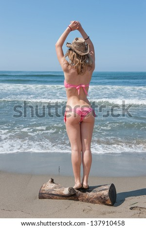 girl on the beach with hat - stock photo