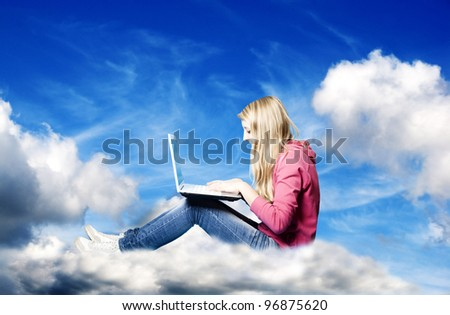 girl on the cloud with a computer - stock photo