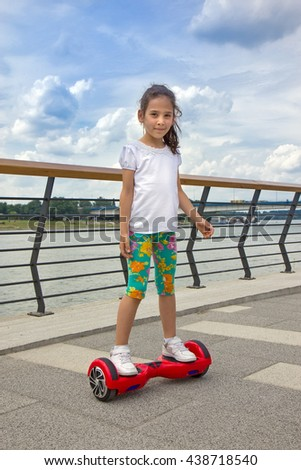 Girl on the hover board - stock photo