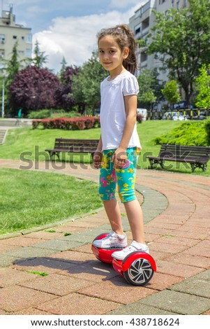 Girl on the hoverboard - stock photo