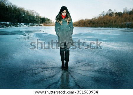 Girl on the ice crack - stock photo