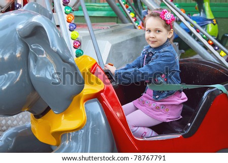 Girl on the merry-go-round in the park