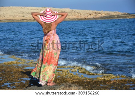 Girl on the rock, Cyprus - stock photo