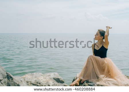 girl on the rocks on the shore