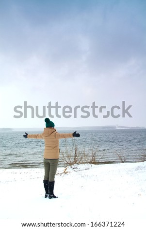 girl on the sea of snow - stock photo