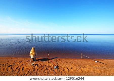 Girl on the seashore - stock photo