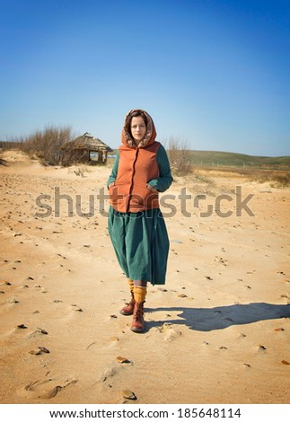 girl on the seashore. Early spring