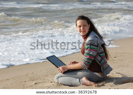 girl on the seashore with notebook