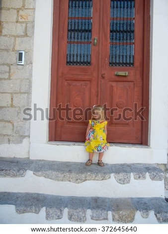Girl on the steps in Hydra - stock photo