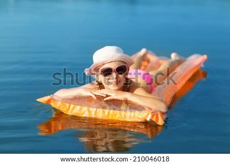 girl on the swimming mattress - stock photo