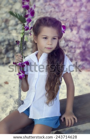 Girl on the swing with orchids - stock photo