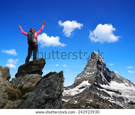 Girl on the top, in the background mount Matterhorn - Swiss Alps, Europe  - stock photo