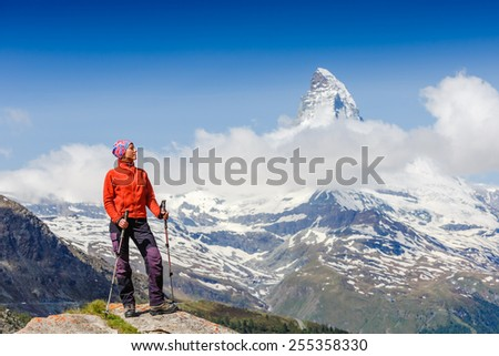 Girl on the top, in the background mount Matterhorn - Swiss Alps, Europe