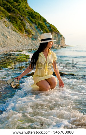 girl on walk on sea seaside - stock photo