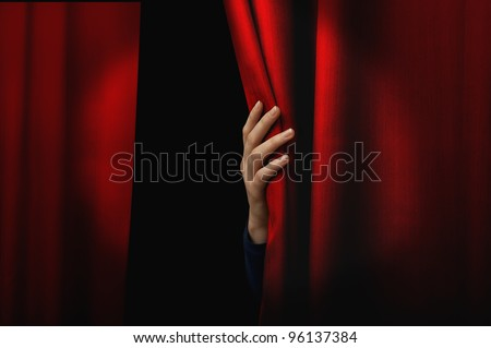 Girl open a red curtain - stock photo