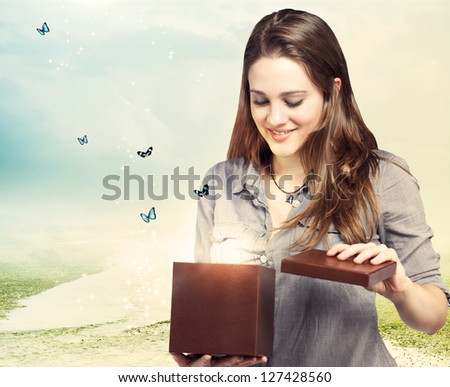 Girl Opening a Magical Gift Box with Butterflies - stock photo