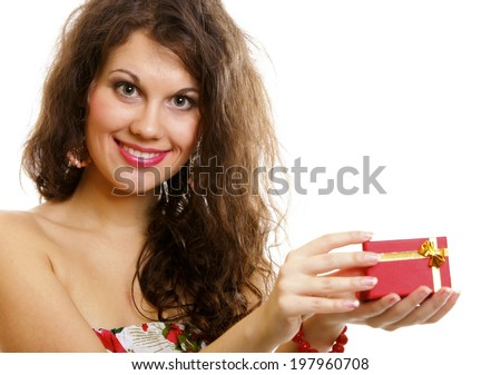 Girl opening small red gift box with gold bow isolated on white background - stock photo