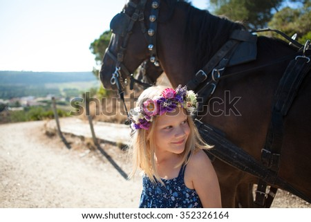 Girl outdoor with a horse on a summer day - stock photo