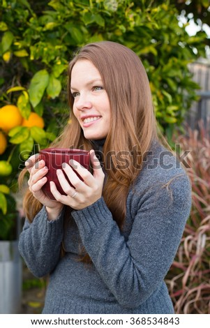 Girl Outdoors with Drink