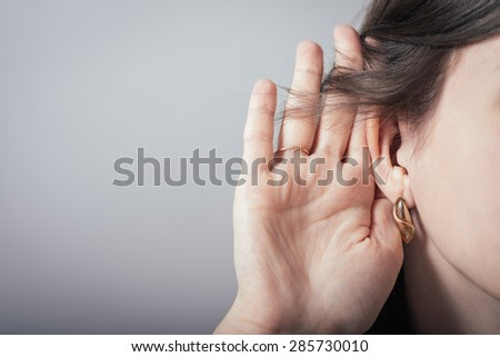 girl overhears - stock photo