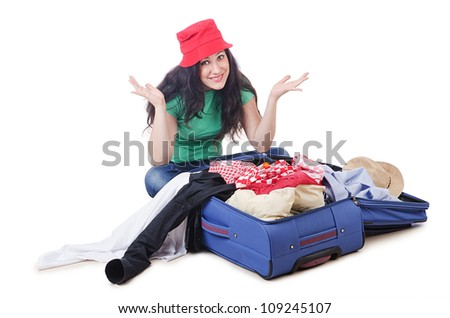 Girl packing for travel vacation