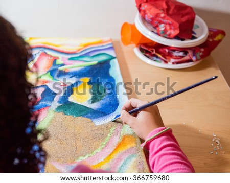 girl   painting picture with paintbrush - stock photo
