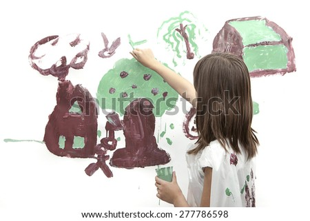 Girl paints a picture. - stock photo
