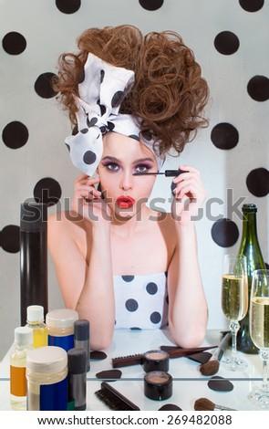 Girl paints eyelashes mascara  - stock photo