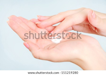 Girl palm with hand cream  - stock photo