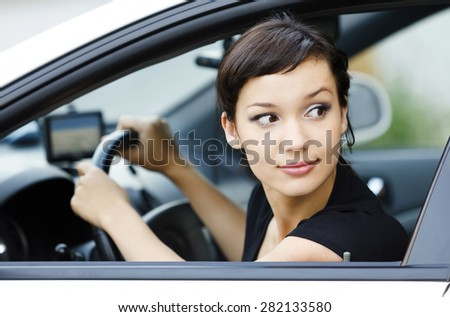 Girl parking a car - stock photo