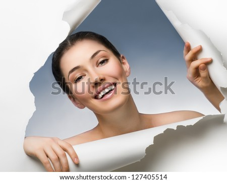 girl peeking out of the hole