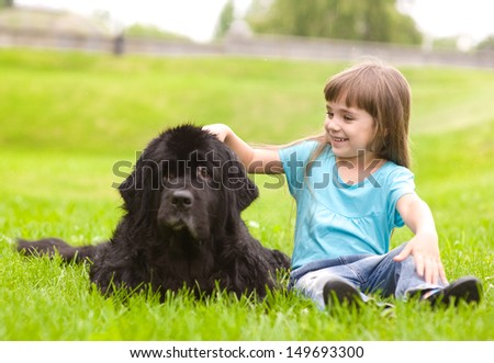 Girl petting a dog - stock photo