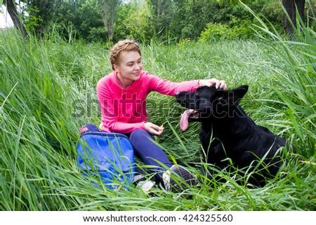girl petting a dog - stock photo